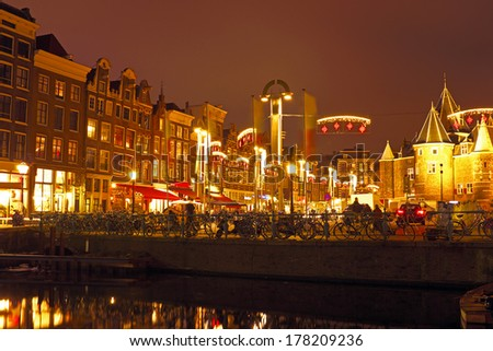 Amsterdam  by night in the Netherlands with the Waag building - stock photo