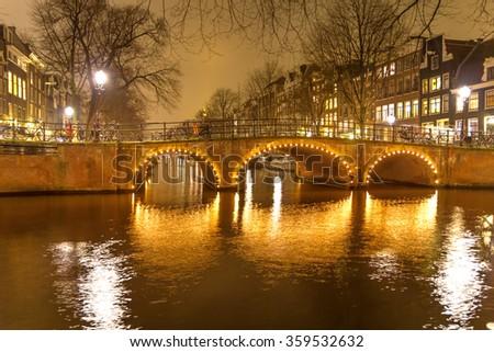 Amsterdam canal and bridge at night - stock photo
