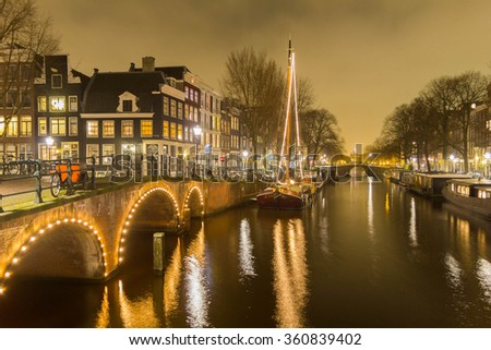 Amsterdam canal and bridge at night