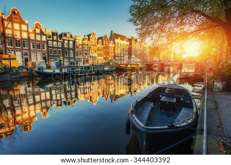 Amsterdam canal at sunset. Amsterdam is the capital and most populous city in Netherlands.  - stock photo