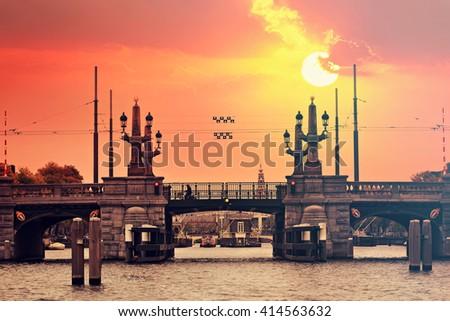 Amsterdam canal bridge at sunset. Netherlands,Europe. Toned colors vintage photo - stock photo
