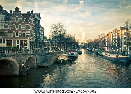 Amsterdam Canal Street view at Sunset. Horizontal filtered shot - stock photo
