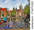 Amsterdam, canals and bikes - stock photo