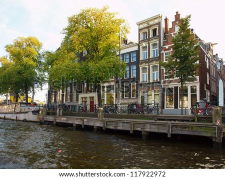 Amsterdam canals and typical houses with clear summer sky. - stock photo