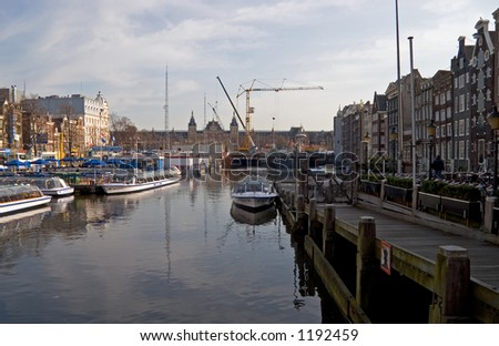 Amsterdam Central Station with canal boats