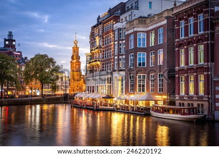 Amsterdam clock tower is one of attractions near the flower market  in Amsterdam, Netherlands. - stock photo