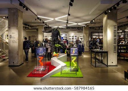 Interior Of A Nike Signature Store With Display And Several