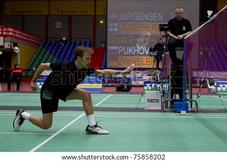 AMSTERDAM - FEBRUARY 19: Marc Zwiebler (pictured) beats Stanislav Pukhov in the semi-finals of the European Team Championships badminton in Amsterdam, The Netherlands on February 19, 2011. - stock photo