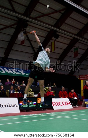 AMSTERDAM - FEBRUARY 19: Stanislav Pukhov (pictured) beats Rune Massing in the quarter-finals of the European Team Championships badminton in Amsterdam, The Netherlands on February 19, 2011. - stock photo