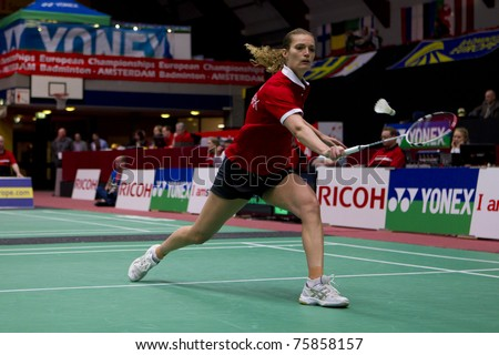 AMSTERDAM - FEBRUARY 19: Tine Baun (pictured) beats Sarah Walker in the semi-finals of the European Team Championships badminton in Amsterdam, The Netherlands on February 19, 2011. - stock photo