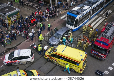 Amsterdam, Holland, August 26, 2014: Birds-eye view of emergency services, police, fire brigade and ambulance at the scene of a traffic accident between a tram and a car - stock photo