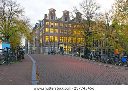 Amsterdam houses at twilight in the Netherlands - stock photo