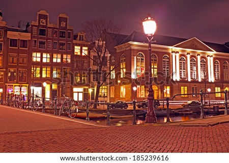 Amsterdam houses by night in the Netherlands - stock photo