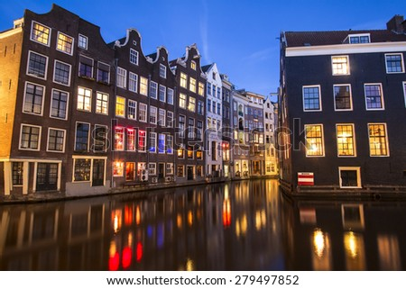 Amsterdam houses in water in evening