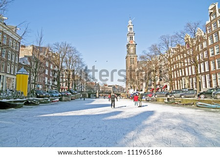 Amsterdam in winter with the Westerkerk in the Netherlands - stock photo