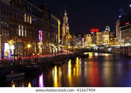Amsterdam innercity by night with the Munttower in the Netherlands - stock photo