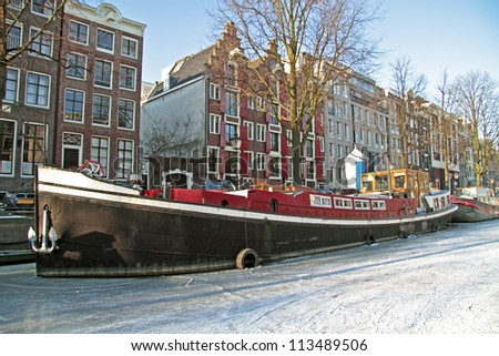 Amsterdam innercity in winter in the Netherlands - stock photo