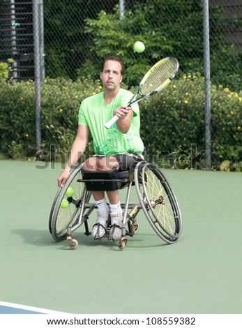 AMSTERDAM - JULY 21: Unidentified athlete participates in Amsterdam Open Wheelchair Tennis competition, held on July 21, 2012 in Amsterdam,The Netherlands - stock photo