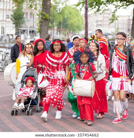 AMSTERDAM-JULY 1:Unidentified Surinamese community celebrates abolition of slavery in former Dutch colonies during the annual Keti Koti ('cut chain') festival July 1, 2012 in Amsterdam,The Netherlands