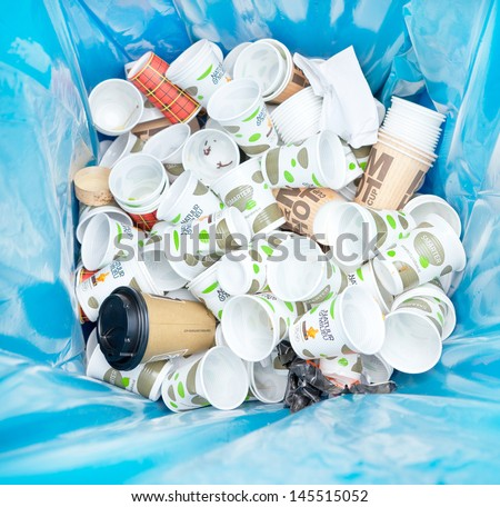 AMSTERDAM - JUNE 29: Different kinds waste gathered separately in waste containers for recycling on the Damn Food Waste day, food waste prevention initiative, June 29, 2013, Amsterdam, The Netherlands - stock photo