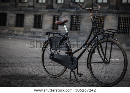 AMSTERDAM - MAY 13: Bicycles parked on a bridge over the canals of Amsterdam,  May 13, 2015. Amsterdam is one of the most bicycle-friendly large cities in the world. - stock photo