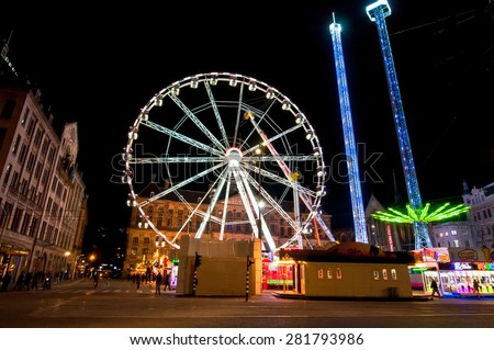 AMSTERDAM,NETHERLANDS-APRIL 27: Big wheel on Dam Square at night on King's Day on April 27,2015 in Amsterdam.  King's Day is the largest open-air festivity in Amsterdam.