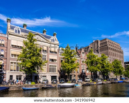AMSTERDAM, NETHERLANDS - AUG 26: Cityscape of Amsterdam in Netherlands on August 26, 2013. Amsterdam is the capital city and most populous city of the Kingdom of the Netherlands. - stock photo