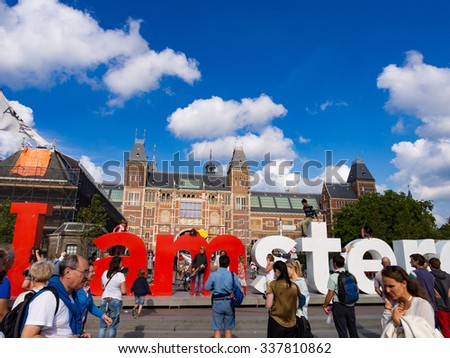 AMSTERDAM, NETHERLANDS - AUG 30: Museumplein in Amsterdam, Netherlands on August 30, 2013. Amsterdam is the capital city and most populous city of the Kingdom of the Netherlands. - stock photo