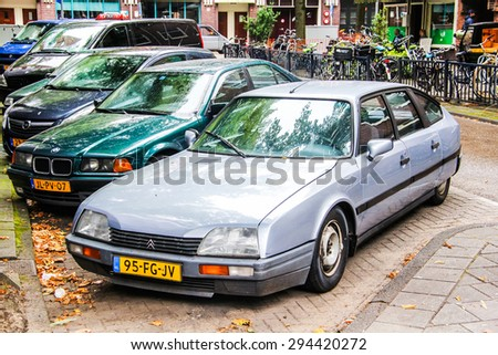 AMSTERDAM, NETHERLANDS - AUGUST 10, 2014: French retro car Citroen CX at the city street. - stock photo