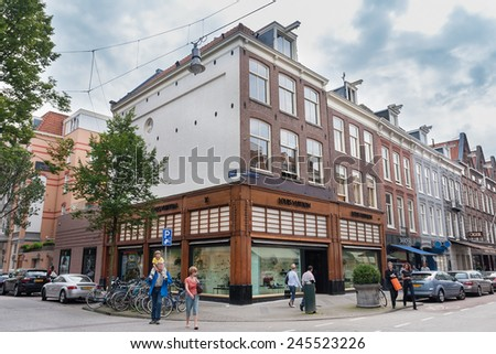 AMSTERDAM, NETHERLANDS - AUGUST 2, 2007: Louis Vuitton store on the corner of Hooftstraat and Pieter Cornelisz Hooftstraat. - stock photo
