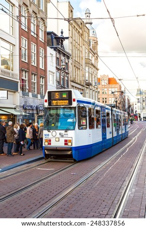 AMSTERDAM, NETHERLANDS - AUGUST 19: Modern tram in Amsterdam. Amsterdam is the capital and most populous city of the Netherlands on August 19, 2014