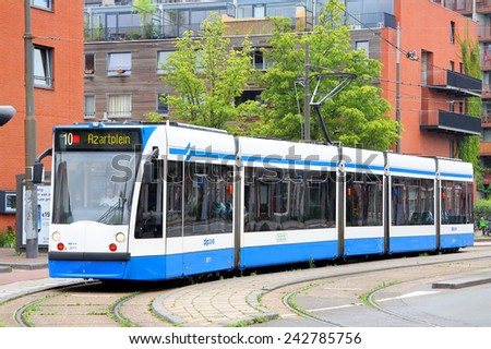 AMSTERDAM, NETHERLANDS - AUGUST 10, 2014: Modern tram Siemens Combino at the city street. - stock photo