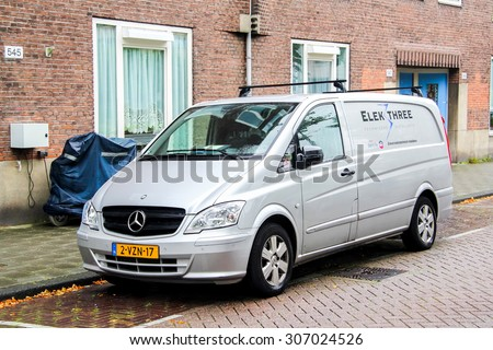 AMSTERDAM, NETHERLANDS - AUGUST 10, 2014: Motor car Mercedes-Benz W639 Vito at the city street. - stock photo
