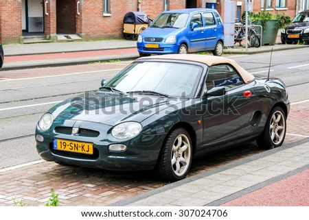 AMSTERDAM, NETHERLANDS - AUGUST 10, 2014: Motor car MG F at the city street. - stock photo