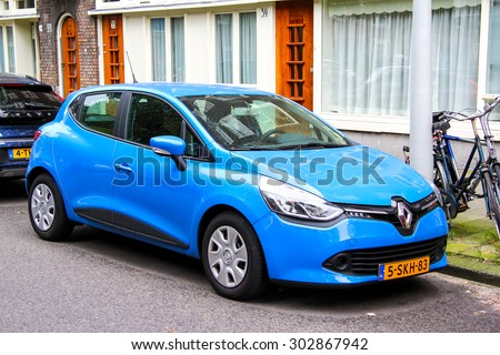 AMSTERDAM, NETHERLANDS - AUGUST 10, 2014: Motor car Renault Clio at the city street. - stock photo