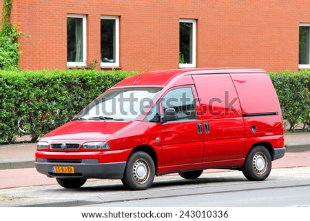 AMSTERDAM, NETHERLANDS - AUGUST 10, 2014: Small cargo van Fiat Scudo at the city street. - stock photo