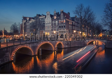 Amsterdam, Netherlands canals and bridges. Night view of Keizersgracht and famous touristic place - stock photo