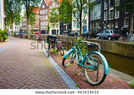 AMSTERDAM, NETHERLANDS - CIRCA SEPTEMBER 2015: City streets life. Touristic center bicycles..