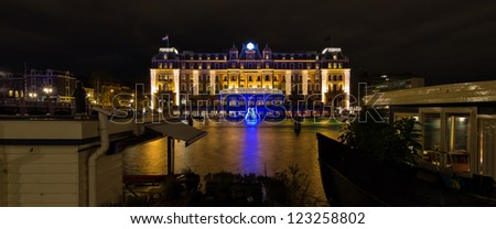 AMSTERDAM, NETHERLANDS - DEC 29: Panorama of the five star Amstel hotel at night during the Amsterdam Light festival in Amsterdam, the Netherlands on December 29, 2012 - stock photo