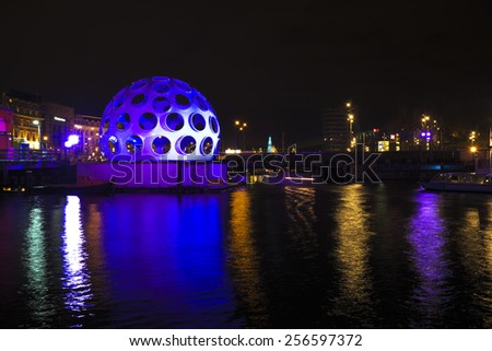 AMSTERDAM, NETHERLANDS - DEC 26 2013: Piece of light art at night during the Amsterdam Light festival in Amsterdam, the Netherlands on December 26, 2013 - stock photo