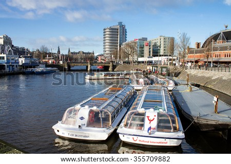 Amsterdam,Netherlands â?? December 23, 2015 : Amsterdam canal bus during Christmas 2015