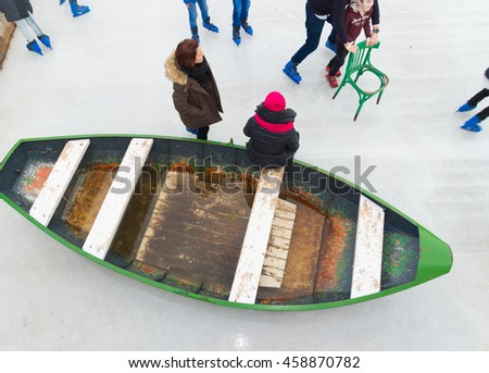 AMSTERDAM, NETHERLANDS - DECEMBER 26, 2015: old boat on a rink in amsterdam