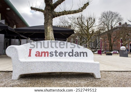AMSTERDAM, NETHERLANDS - FEBRUARY 07: I Amsterdam city urban furniture welcome sign in museum square, on February 07, 2015 in Amsterdam. - stock photo