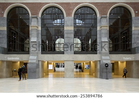 AMSTERDAM, NETHERLANDS - FEBRUARY 10: Visitors at Rijksmuseum hall on February 10, 2015 in Amsterdam. The Rijksmuseum is located at the Museum Square, was designed by Pierre Cuypers and opened in 1885 - stock photo