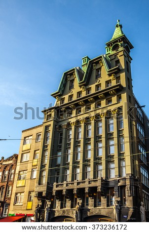 AMSTERDAM, NETHERLANDS - JANUARY 15, 2016: Famous buildings of Amsterdam city centre close-up at sun set time. General landscape view. Amsterdam - Netherlands.