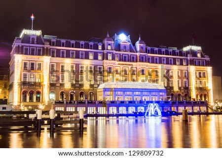 AMSTERDAM, NETHERLANDS - JANUARY 13: Illuminated 5-star Amstel hotel with in front a blue fountain, an element of the first edition of the Amsterdam Light Festival on January 13, 2013 in Amsterdam. - stock photo