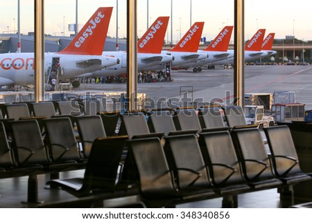 AMSTERDAM, NETHERLANDS - JULY 6, 2014: EasyJet Airbus A320 tails at Schiphol airport, Netherlands - stock photo