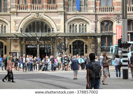 Amsterdam,Netherlands - July 2, 2013 : People waiting for green light to cross the street in center of Amsterdam