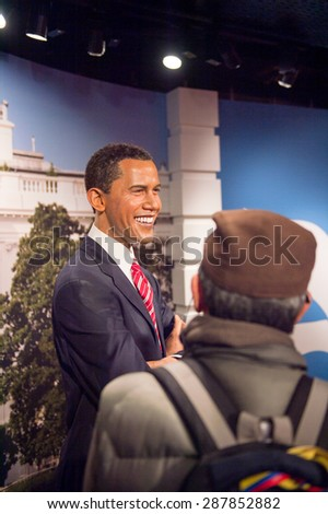 AMSTERDAM, NETHERLANDS - JUN 1, 2015: Barack Obama, the USA president, in the Madame Tussauds museum in Amsterdam. Marie Tussaud was born as Marie Grosholtz in 1761