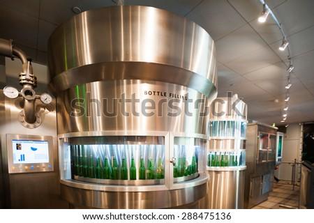AMSTERDAM, NETHERLANDS - JUN 3, 2015: Bottles of Heineken at the Heineken Experience center, a historic brewery for Heineken beer. Gerard Adriaan Heineken was a founder of the Heineken beer